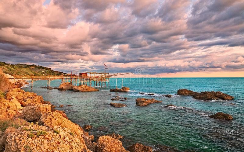 Rocca San Giovanni, Chieti, Abruzzo, Italy: Adriatic sea coast l. Rocca San Giovanni, Chieti, Abruzzo, Italy: landscape of the Adriatic sea coast at dawn with a royalty free stock image