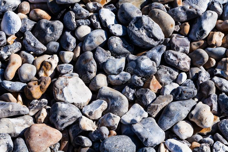 Rocce della spiaggia nel macro fondo di immagine del primo piano Immagine di sfondo di concetto della spiaggia e di festa immagine stock libera da diritti
