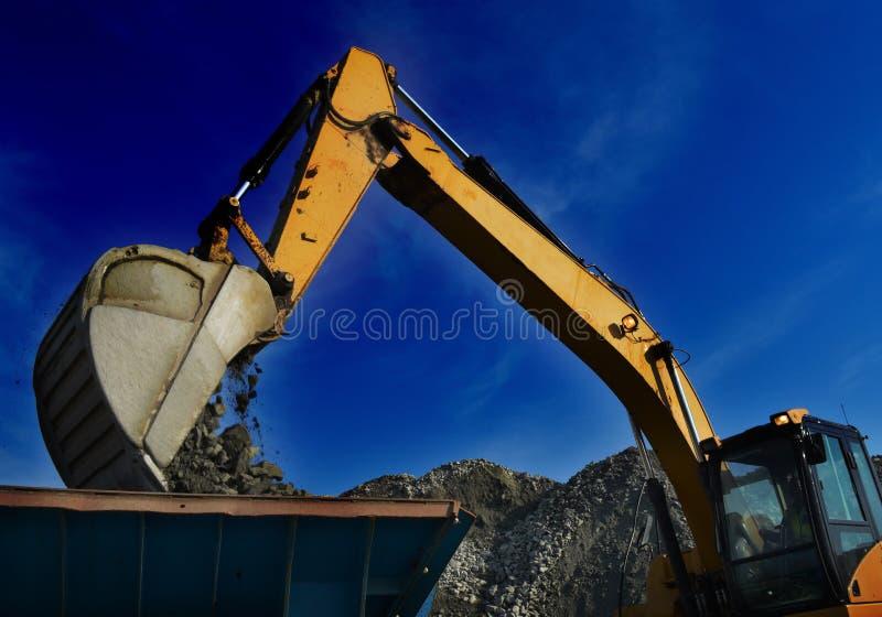 Roccia commovente dello zappatore di estrazione mineraria immagine stock