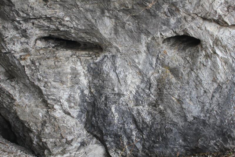 Roccia con uno sguardo umano Natura di capricci fotografia stock libera da diritti