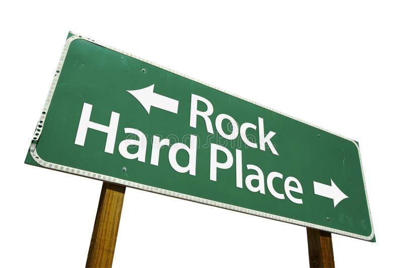 Roccia, segnale stradale duro del posto fotografia stock