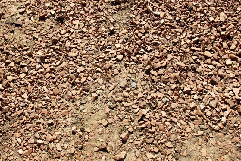 Rocha e fim de pedra da terra da areia acima Opinião superior do fundo da textura imagem de stock royalty free