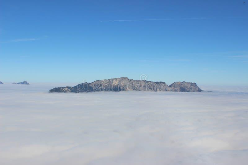 A rocha nas nuvens imagens de stock royalty free