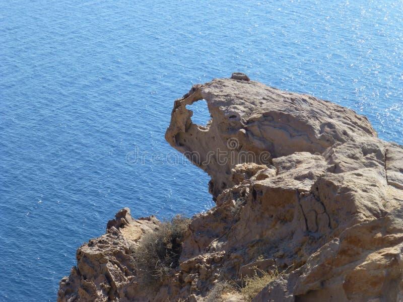 Rocha sobre o mar com um furo foto de stock royalty free