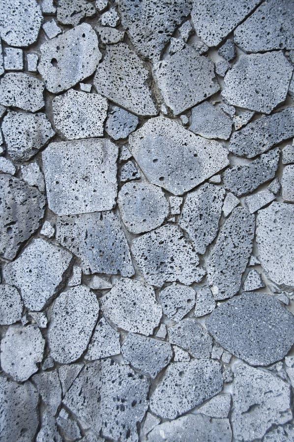 Rocha vulcânica ou de rocha da lava parede como o fundo imagens de stock