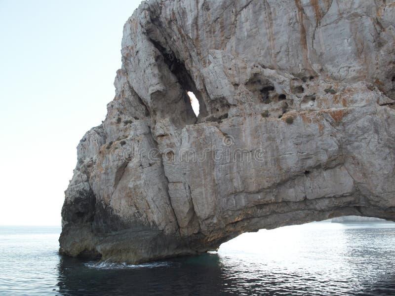 Rochas de Ibiza no mar imagem de stock