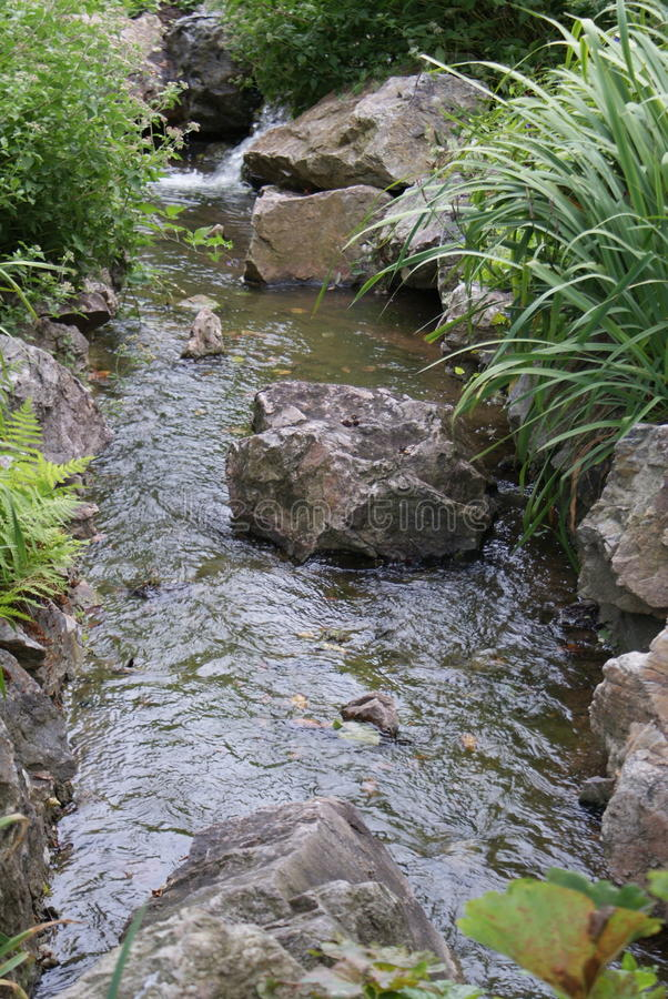 Rochas na água fotografia de stock