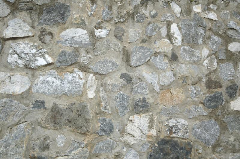 Roche sur la texture de mur de ciment photos libres de droits