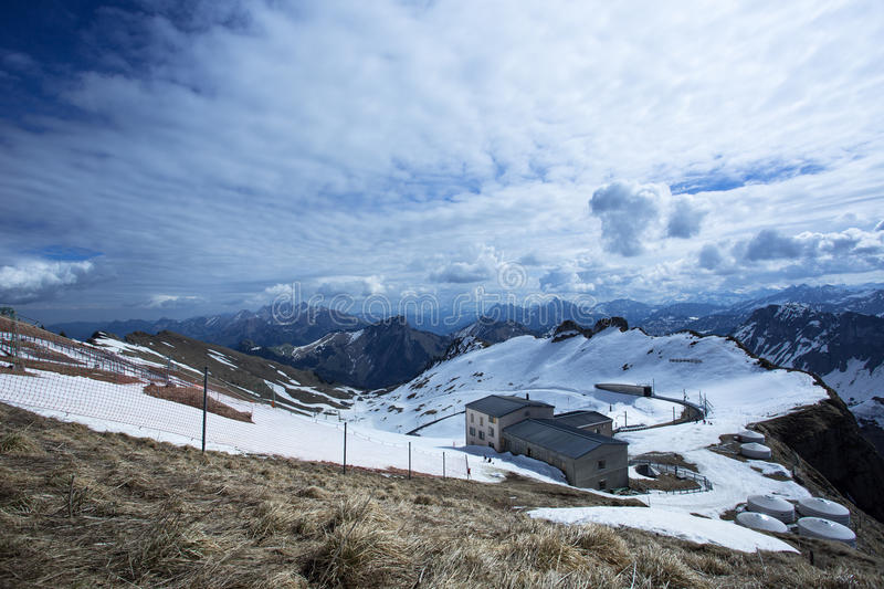 Rochers-de-Naye Station From Lookout. Rochers de Naye, is a mountain of the Swiss Alps near Montreux. Few minutes walking uphill, is a lookout that is offering a royalty free stock photos