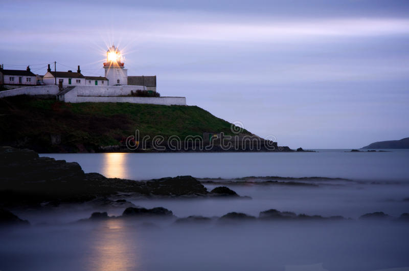 Roches Point Lighthouse in Cork at Dusk stock photos