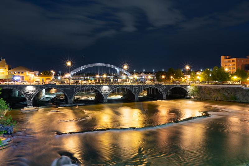 Rochester New York Along the Genesee River at Night. ROCHESTER, NY - MAY 14, 2018: Broad Street Bridge in Rochester, New York along the Genesee River at night royalty free stock photos