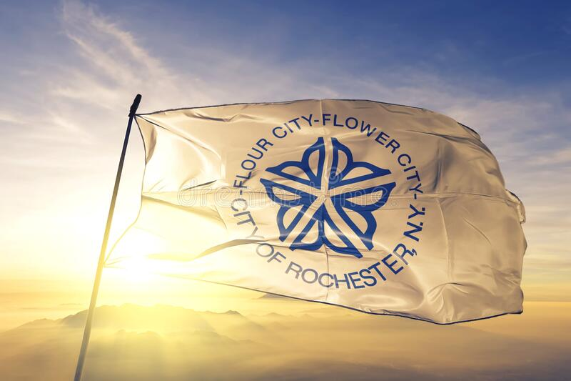Rochester of New York of United States flag waving on the top. Rochester of New York of United States flag waving royalty free stock photos
