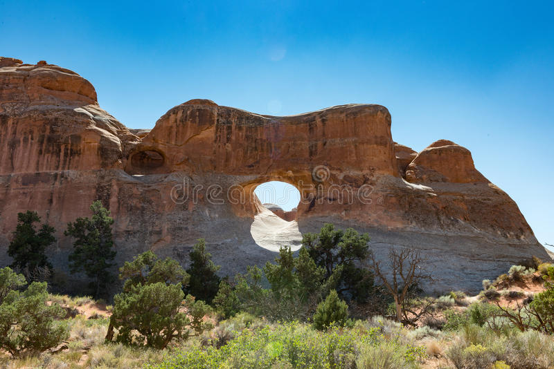 Rock Arch with Sun stock image