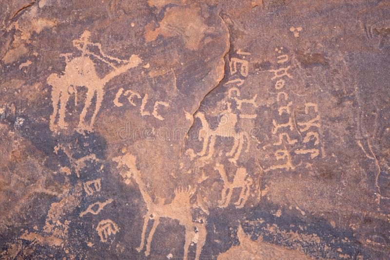 Ancient cave paintings / rock art in Ha`il Province in Saudi Arabia world heritage site. This rock art is said to be about 10,000 years old and is a World stock photo