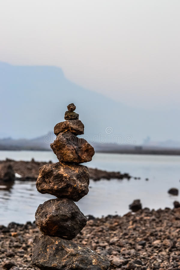Rock Balancing. At Morbe Dam, Karjat, India stock photography