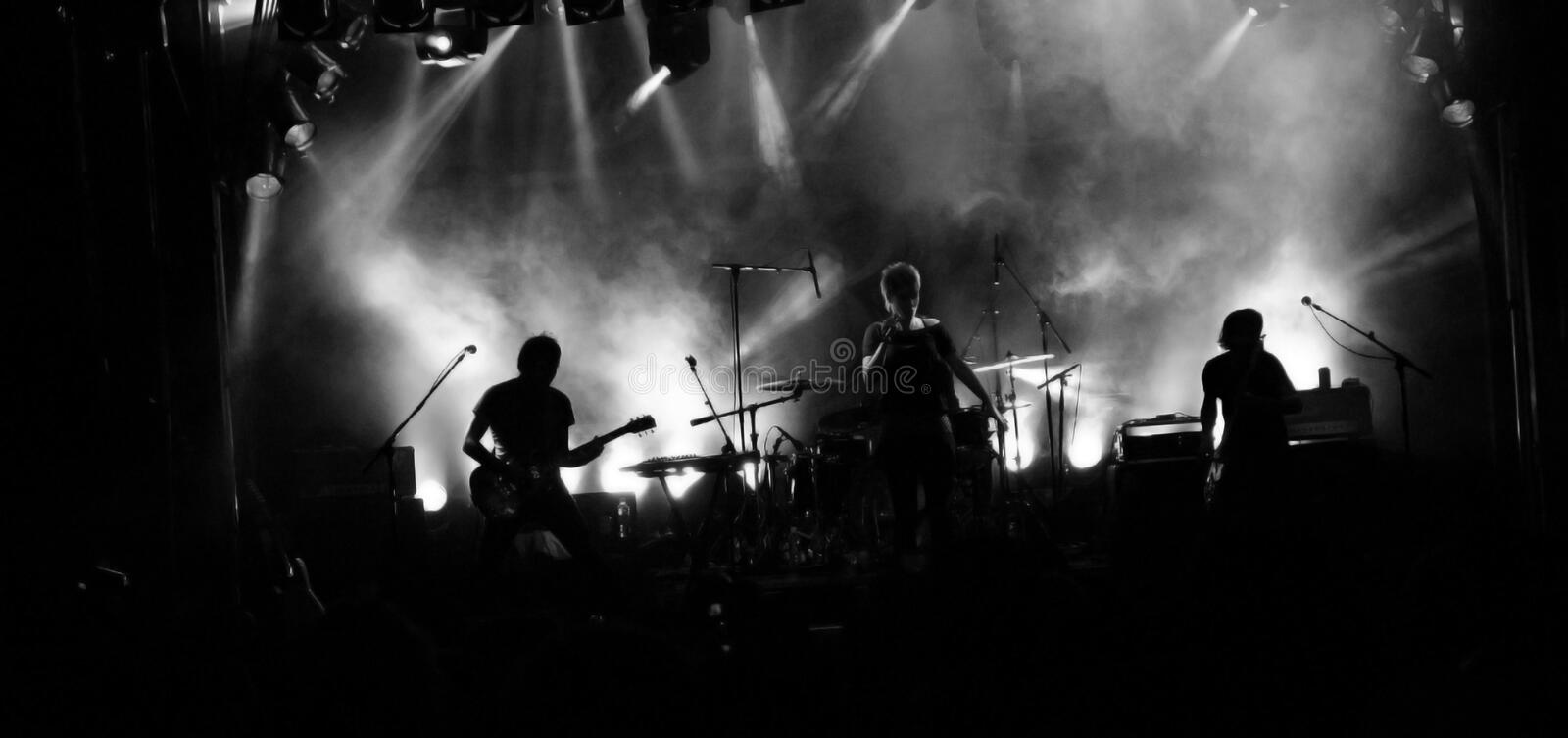 Rock Band Silhouette. The silhouette of a rock band performing on stage royalty free stock images