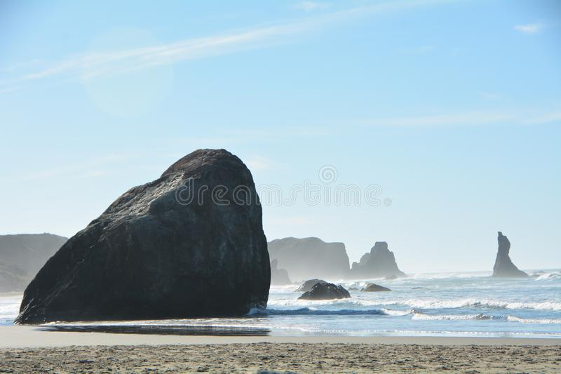 A rock on the beach at Bandon, Oregon. This is one of the large remnants of Oregon`s former coast line at Bandon, Oregon stock photography