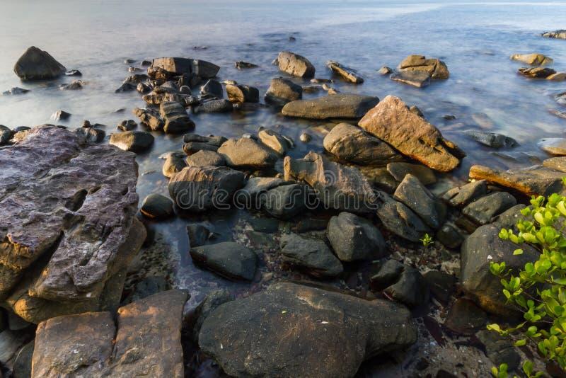 Rock on beach stock photo