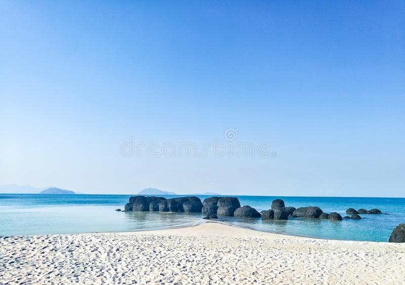 Rock on the beach at the sea in Thailand royalty free stock images