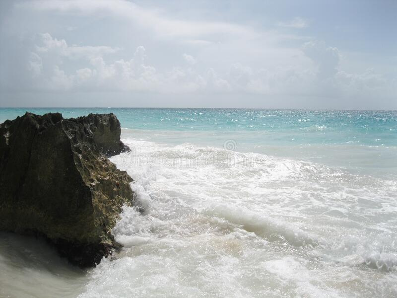 Rock on beach stock photography