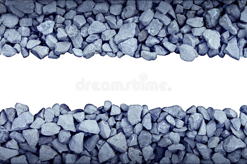 Rock Border Design Element. With broken grey stones forming a wall pattern with blank white background as a symbol of rough nature or mining stock photos