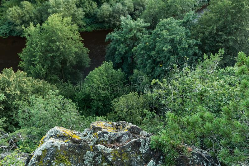 Rock from bottom, view to valley with Vltava river and trees, Czech republic.  stock photo