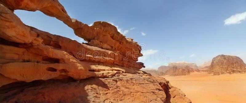 Rock bridge and panoramic view of Wadi Rum royalty free stock image