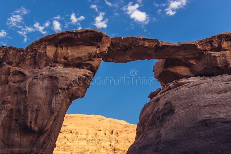 Rock bridge in Wadi Rum valley stock images