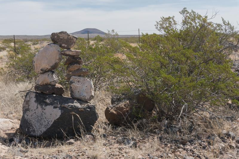 Rock cairn along state highway nine in New Mexico. stock images