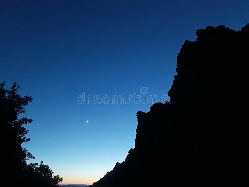 Rock Canyon At Twilight with Moon stock images