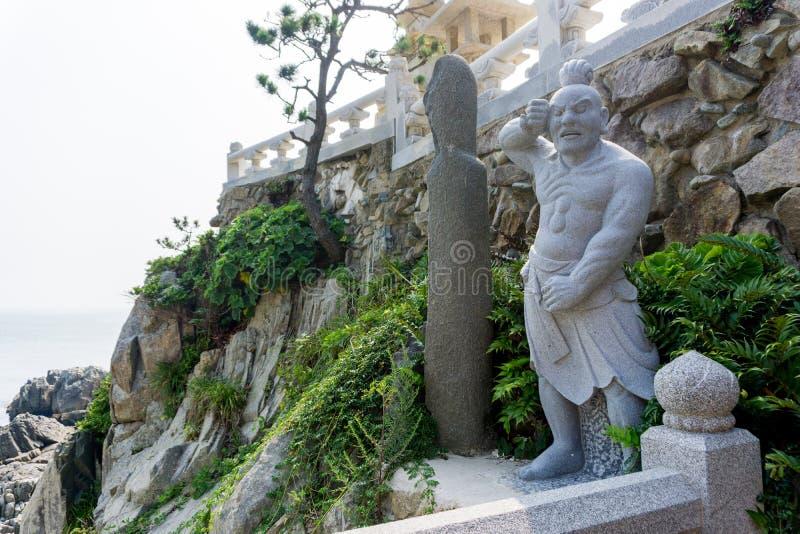 Rock carving Chinese giant statue at Haedong Yonggungsa Temple. In Busan, South Korea stock images