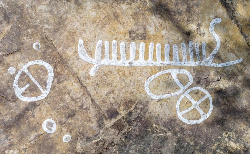 Rock carvings. Dating back about 3000 years near the town of Lidkoping, Sweden royalty free stock photos