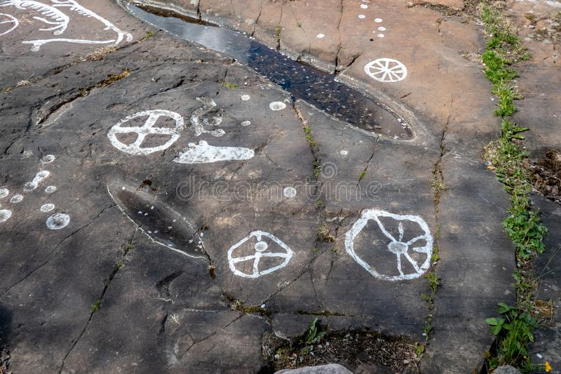 Rock carvings. Dating back about 3000 years near the town of Lidkoping, Sweden stock images