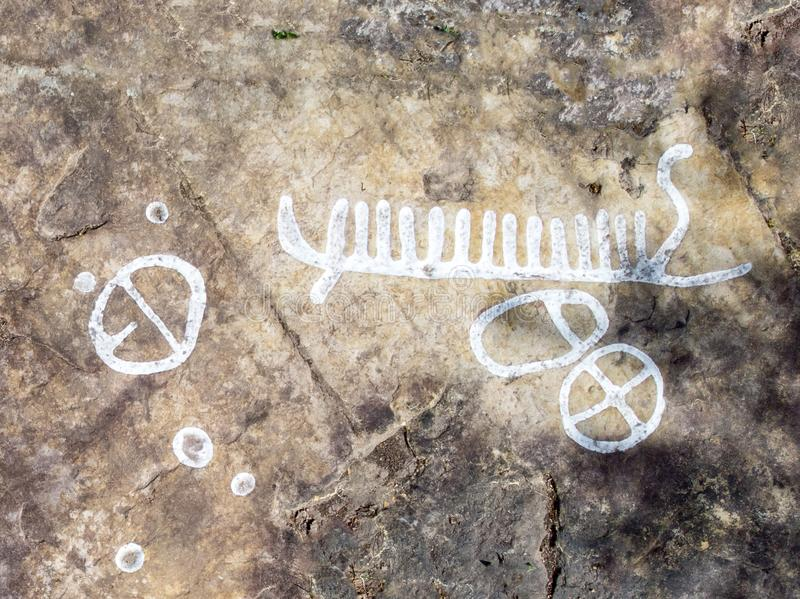 Rock carvings. Dating back about 3000 years near the town of Lidkoping, Sweden royalty free stock image