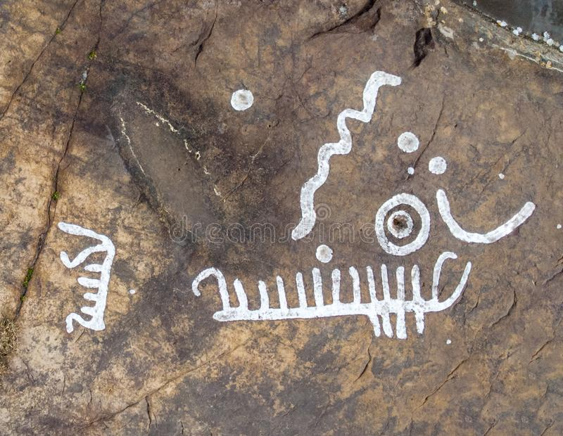 Rock carvings. Dating back about 3000 years near the town of Lidkoping, Sweden royalty free stock photography
