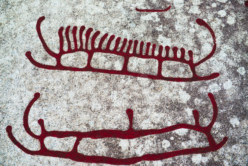 Rock Carvings. In Tanum. One of UNESCO's world heritages. From UNESCOs website: The  in Tanum, in the north of Bohuslän, are a unique artistic achievement royalty free illustration