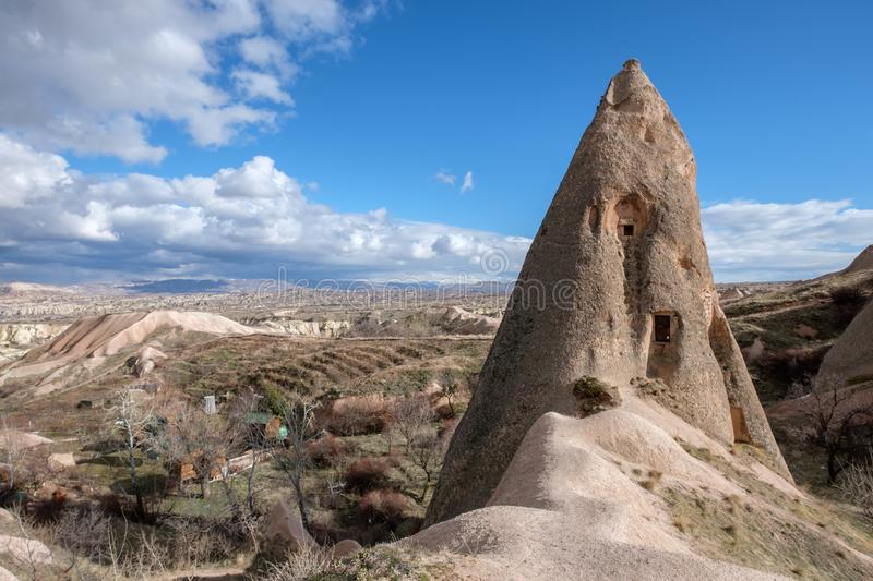 A rock with a cave house in Uchisar, Cappadocia, Turkey royalty free stock photo
