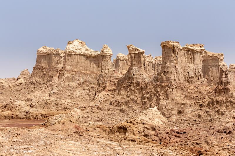 Rock city in Danakil depression, Ethiopia, Africa. High rock formations rise in the Danakil depression like stone rock city. Landscape like Moonscape, Danakil royalty free stock images