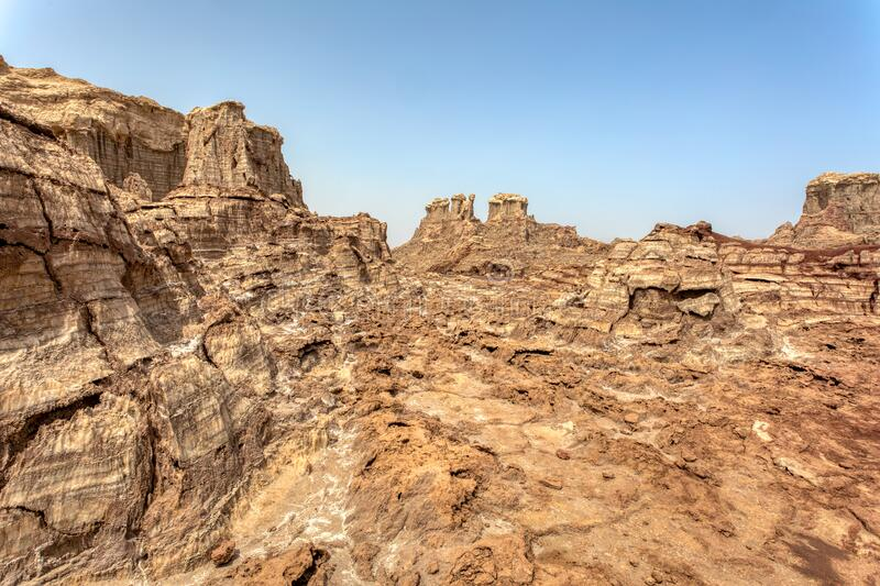 Rock city in Danakil depression, Ethiopia, Africa. High rock formations rise in the Danakil depression like stone rock city. Landscape like Moonscape, Danakil royalty free stock photography