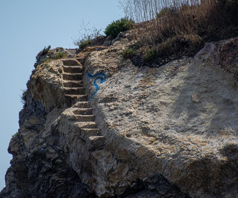Rock cliff stairway going nowhere royalty free stock images