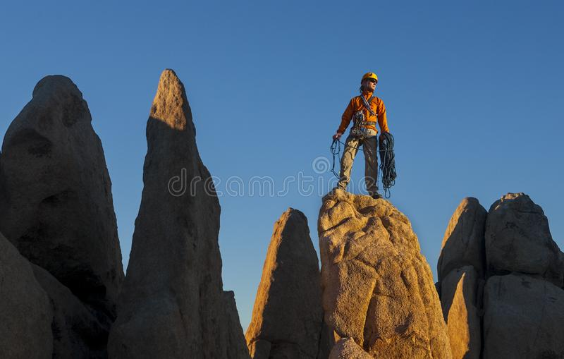 Rock climber celebrates on the summit stock images