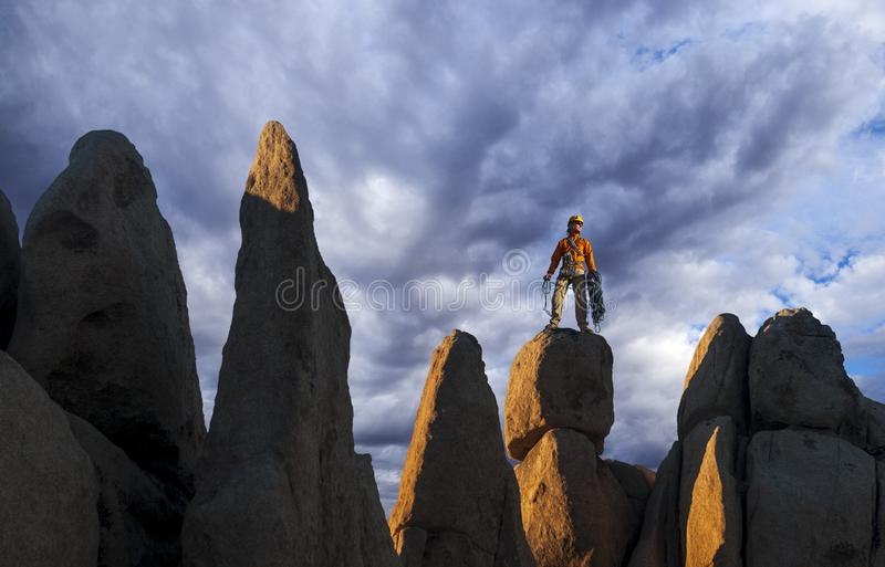 Rock climber celebrates on the summit royalty free stock images