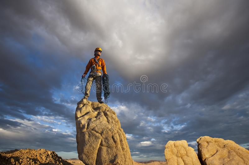 Rock climber celebrates on the summit royalty free stock photos