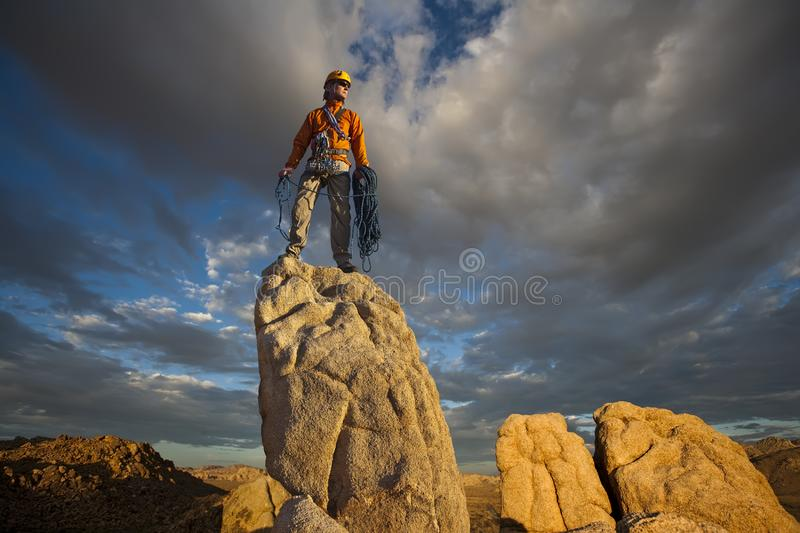 Rock climber celebrates on the summit stock photos