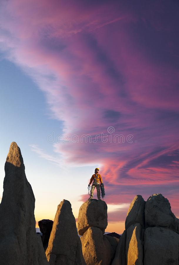 Rock climber celebrates on the summit stock photo