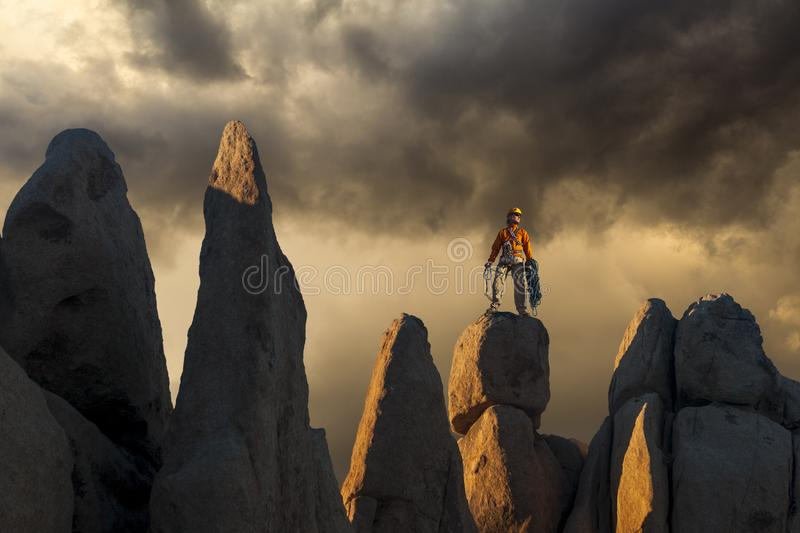 Rock climber celebrates on the summit royalty free stock photography