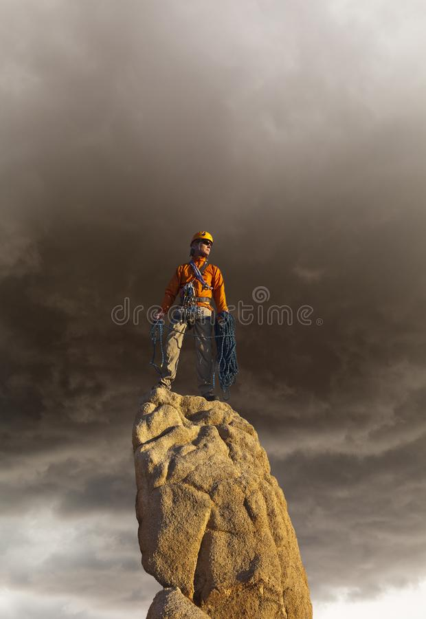 Rock climber celebrates on the summit stock image