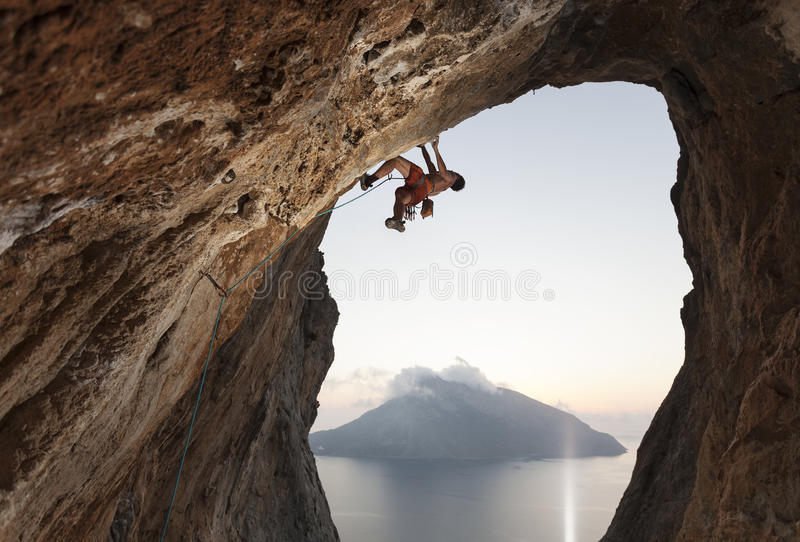 Rock climber on cliff royalty free stock photography