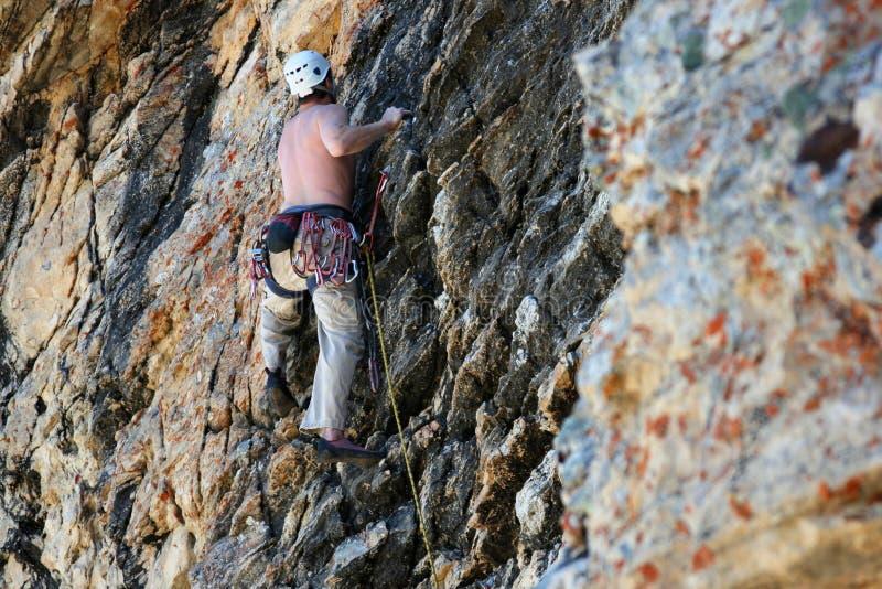 Rock climber / climbing stock photos