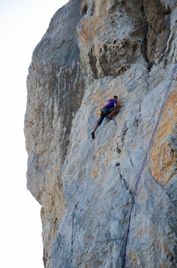 Rock climber climbs the cliff, close-up view stock images